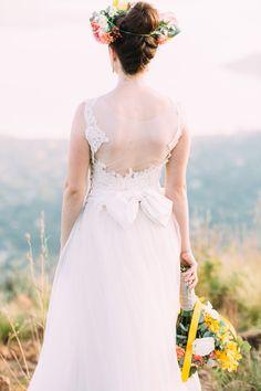 swoon. photo by Lad  Lass http://ruffledblog.com/villa-paradiso-wedding #weddingdress #bride #floralcrown