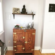 Bujamadesig.com Finally finished the bar area with a wood shelf from Etsy, our Buddha, and a cool photo wood transfer. #diy #bujamadesign #decor #iceboxbar
