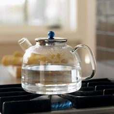 Heat-proof lab glass tea kettle with a cool blue knob on its lid and large ergonomic handle. Holds 60 ounces, works with gas or electric heat, and is dishwasher safe. For Rachel