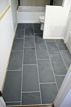 Large Floor Tiles In A Small Bathroom Really Makes An Impact  Dom Delectable Small Bathroom Flooring Design Inspiration