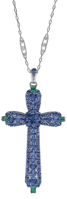 LOUIS COMFORT TIFFANY FOR TIFFANY & CO. A RARE SAPPHIRE AND EMERALD PENDANT NECKLACE, CIRCA 1915. The Latin cross pendant set with graduated circular-cut sapphires, enhanced by baguette-cut emerald accents at the centre and cardinal points, to the circula