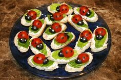Ingredients: 15 thin slices of a baguette Cream Cheese (of your taste) a couple romaine lettuce leaves 8 cherry tomatoes 8 large pitted black olives Description: In the oven, broil the baguette sli…
