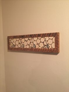 Coat rack. Spruce tree discs framed by the edges of old 2x4s.
