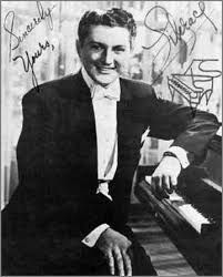 Liberace, my Mum loved watching him on a Sunday afternoon whilst ironing our clothes for school the next day.
