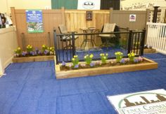 Glass railing on deck at the West Michigan Home & Garden Show 2014.  Glass railing can add beauty and distinction to any yard or business.