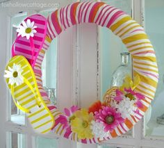 Pool Noodle Crafts: Flip Flop wreath (Hubs would never allow pink on our front door, but I love this idea for a summer wreath, add a cute pinwheel too!) Going to Dollar Store now!