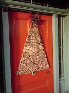 This 4 ft. Christmas door decor is made entirely of wine corks . . . .lots of 5 o'clocks somewhere.
