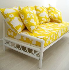 Old sofa/daybed recovered in a beautiful yellow and white print.