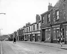 Properties including Nos. 53, Gladys Burgoin, ladies hairdresser, 51-43 J.C. Shirtcliffe Ltd., outfitters and house furnishers, Regent Street looking towards Glossop Road