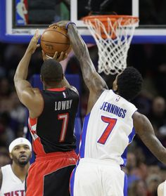 Detroit Pistons guard Brandon Jennings (7) blocks a shot by Toronto Raptors guard Kyle Lowry (7) during the first half of an NBA basketball game in Auburn Hills, Mich., Friday, Dec. 19, 2014. (AP Photo/Carlos Osorio)