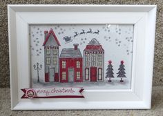 """Holiday Home frame 3 This is a 6"""" x4"""" frame the houses were stamped and cut out and stuck on to the stamped background. You could just stamp it all on a background."""
