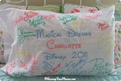 Disney character autographs on a pillow