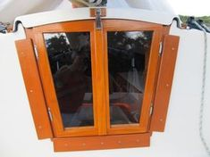 Perfect diy companionway, NO drilling into the boat and you can switch out for screens - Tap on the link to see the newly released collections for amazing beach bikinis! Sailboat Living, Living On A Boat, Sailboat Interior, Yacht Interior, E Motor, Boat Restoration, Small Sailboats, Wood Boat Plans, Boat Storage