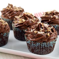 Chocolate Italian Wedding Cupcakes with Chocolate Sour Cream Frosting by EvilShenanigans, via Flickr