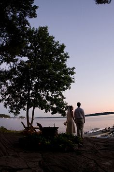 bride and groom at sunset on lake muskoka - photo by canadian destination wedding phtographer Stacey Wight