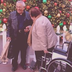 This picture warms my heart. They are too cute!!! :) #cuteoldcouple #grandparents #adorable #christmas #outletsattejon #helpinghand