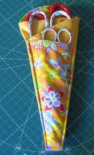 Folded Fabric Scissor Holder-Rounded Top Version Tutorial....I really like this pattern and it can be done with oilcloth or Chalkcloth!