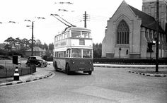 Ipswich double decker on roundabout by St  Augustins church , Felixstowe Road / Heath Road  .England.
