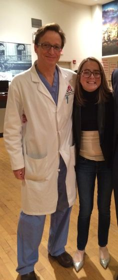 woman standing next to a doctor in white coat