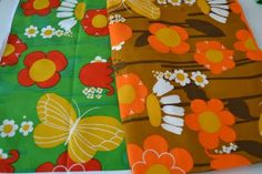 I had a pantsuit in a fabric similar to these, bright yellow and orange flowers!