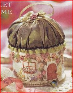 A charming English fairybook cottage pincushion