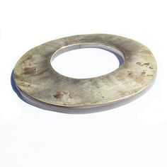 I found it on the ground - Roxy Lentz - Cuff/bangle of repurposed silver plate tray with fire patina. Riveted to found pexi-glass with frosted finish. About 5 inches across, fits a small to medium wrist.