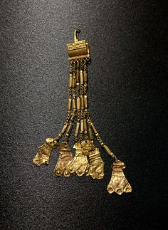 "Basket earrings with pendants shaped as ""idols."" Gold; cat. 15—16. 2400—2300 BCE. Moscow, the Pushkin Museum of Fine Arts"
