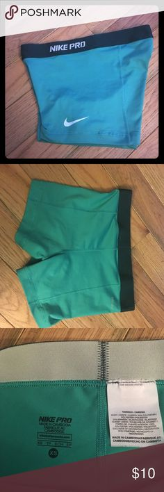 NIKE PRO Shorts Light green Nike shorts. Has dark green waist band. Nike logo on front leg is a little stretched out but otherwise shorts are in excellent condition. Nike Shorts