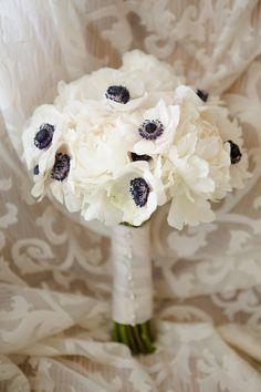 beautiful white anemone bridal bouquet—   http://www.stylemepretty.com/california-weddings/2014/05/16/whimsical-and-elegant-ballroom-wedding-at-fairmont-san-francisco/