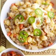 Slow Cooker Loaded Hash Browns -- Layers of sausage, cheese, hash brown potatoes, cheese, and veggies slow simmer into the ultimate side dish. Prep takes just 15 minutes. #Sausage #SlowCooker