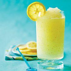 Grown-Up Frozen Lemonade (1/2 cup sugar 1 tablespoon lemon zest  3 cups ice cubes   1/2 cup fresh lemon juice   1/2 cup limoncello liqueur    Garnish: lemon slices)
