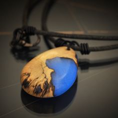 Wood and resin, glowing blue pendant