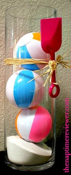 Tiny beach balls in a glass cylinder for a summertime party or a pool party. Centerpiece for a Pool party.