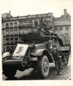 1944, Strasbourg France - French soldiers with a portrait of `ADOLF HITLER