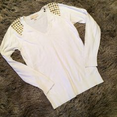 """Michael Kors sweater with gold rivets This sweater is a pure white with gold punch out rivets on the shoulders. V-neck. L:25"""", B:18"""", S:23"""". MICHAEL Michael Kors Sweaters V-Necks"""