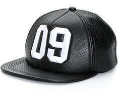 dce067bd359 Take your style from basic to bold with this solid black snapback hat  constructed with a perforated faux leather construction finished with a  contrast white ...