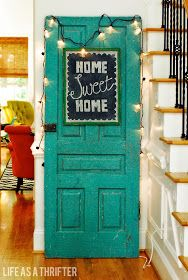 Chalk board decorative door with the cutest lights