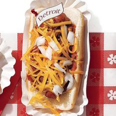 For the Football Feast: Coney Island Dog Detroit is home to the Lions and the dogs — Coney Island Dogs, that is. The famous hot dog was popularized in Detroit. It's served topped with all-beef chili, raw white onion, yellow mustard, and shredded Cheddar, and it's the perfect game day snack. Recipe: Coney Island Dog   - Delish.com