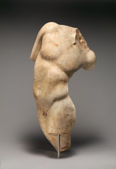 Marble statue of a young satyr turning to look at his tail; Roman, 1st or 2nd century A.D., Marble