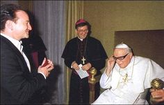 The Pope asked to put on Bono's glasses