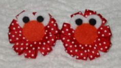 Elmo :) I so need to make C some of these!!  I think I would use red ribbon & maybe googly eyes.