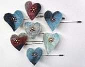 heart shaped felt brooches made by Cornish textile artist! Buy on Etsy