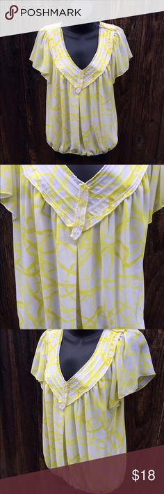 Max Studio graphic blouse This is perfect for a business casual setting! Flowy yellow and white blouse. Has flowy sleeves. Fitted bottom. Detailed neckline. The brand is Max Studio Speciality Products size medium. Max Studio Tops Blouses