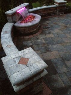 Unilock Brick Paver Brussels Tumbled Wall and 16 color led light and formal falls waterfall. Sunscape Land Design LLC.