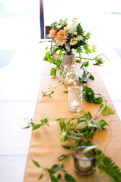 Naomi Rose Floral Design {Melbourne wedding} burlap table runner, lanterns, candles, trailing vine, copper fairy lights, flowers, apricot, white, green, teal