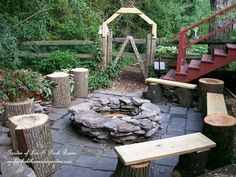 build your own fire pit, outdoor living, patio, Build your own stacked stone fire pit with rustic benches and tables made from logs This project was completed over three days and transformed a weedy slate patio into a family gathering place See my blog at