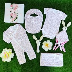 Gorgeous blossom design baby clothing along with a matching bunny rattle and comforter. Personalized Baby Gifts, Gift Hampers, Spring Blossom, Baby Girl Gifts, Baby Design, Comforter, Picnic Blanket, Bunny, Clothing