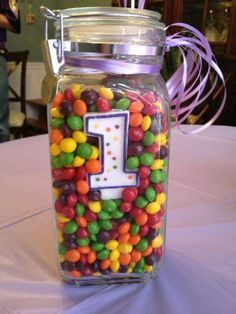 Easy table decor, just add candy and a number candle!