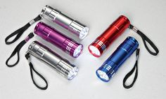 Bell + Howell 9 LED Pocket Size Flashlights Set of 5 5 super-bright, pocket-sized flashlights. Each features 9 bright LED bulbs that last up to 50,000 hours, and the rugged aluminum body is weatherproof, too. One touch on/off button. Set includes red, silver, purple, blue and charcoal.  http://kittykatkoutique.com/products-all/stocking-stuffers-list-ideas/