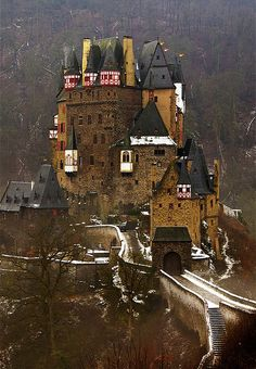 "Burg Eltz is a medieval castle nestled in the hills above the Moselle River between Koblenz and Trier, Germany. [ Images] ""It is still owne..."